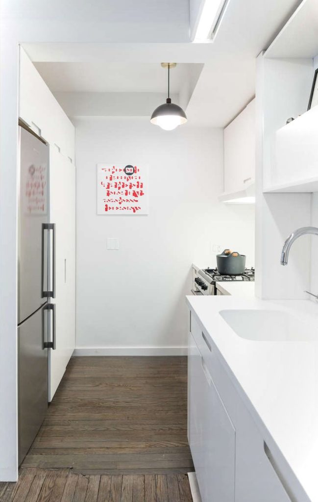 Small Apartment With Motorized Wall Kitchen View