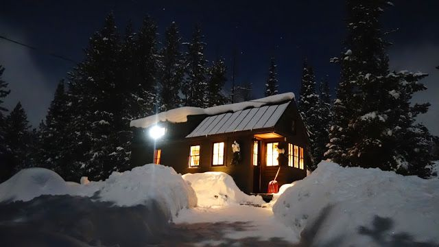 Off-grid Tiny House On Wheels At Night Winter