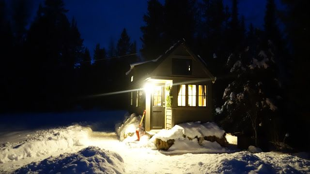 Off-grid Tiny House On Wheels Front View On Winter Night