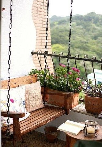 Wooden Swing On Balcony